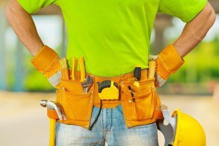21687155 - tools in belt of worker